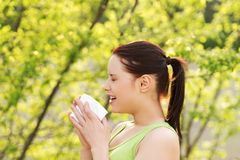 Attractive young woman outdoor with tissue. Royalty Free Stock Photo