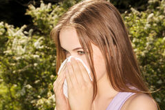 Attractive young woman outdoor with tissue. Stock Photo