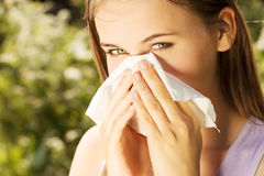 Attractive young woman outdoor with tissue. Attractive young woman outdoor with white tissue Stock Photography