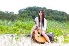 Attractive Young Woman Outdoors With Guitar Royalty Free Stock Images