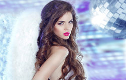 Attractive young woman over disco ball party background, beauty. And fashion concept Stock Photography