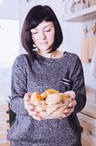 Attractive young woman with pastry stock images
