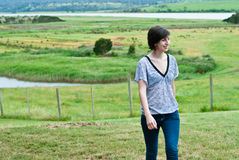 Attractive young woman in pasture Royalty Free Stock Photo