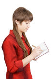 Attractive young woman with pen Stock Photography