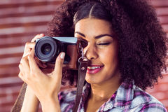 Attractive young woman photographing with camera Stock Images