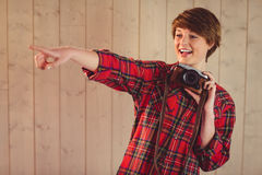 Attractive young woman photographing with camera Royalty Free Stock Image