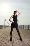 Attractive young woman on the pier Royalty Free Stock Photo