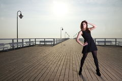 Attractive young woman on the pier Stock Images
