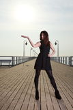 Attractive young woman on the pier Royalty Free Stock Photos