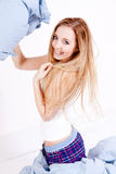 Attractive young woman pillow fight in bedroom Royalty Free Stock Image