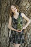 Attractive young woman with pineapple Royalty Free Stock Image