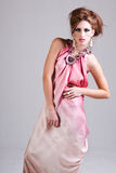 Attractive Young Woman in Pink Dress Stock Images