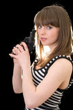 Attractive young woman with pistol stock photos