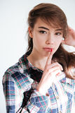 Attractive young woman in plaid shirt showing silence sign Royalty Free Stock Photo