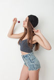 Attractive young woman is playing with candy Stock Photo