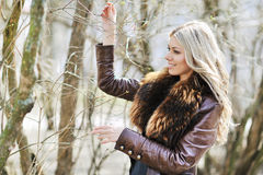 Attractive young woman playing with tussock in spring Royalty Free Stock Photos
