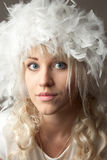 Attractive young woman with a plume hat Royalty Free Stock Photo