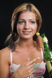 Attractive young woman pointing at a beer bottle. Very high resolution Royalty Free Stock Photography