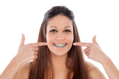 Attractive young woman pointing her brackets Stock Images