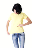 Attractive young woman pointing on her tshirt. Stock Photo