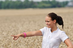Attractive young woman pointing at something Royalty Free Stock Image