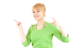 Attractive young woman pointing up Stock Photos