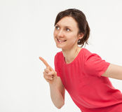Attractive young woman pointing up Stock Photo