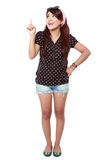 Attractive young woman pointing up Stock Photography