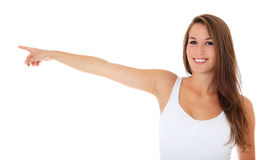 Attractive young woman points with finger Royalty Free Stock Image