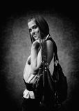 Attractive young woman poses with a bag Stock Images