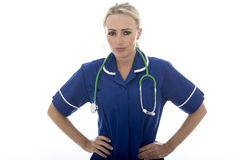 Attractive Young Woman Posing As A Doctor or Nurse Royalty Free Stock Images