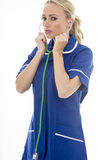 Attractive Young Woman Posing As A Doctor or Nurse In Theatre Sc Stock Image