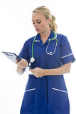 Attractive Young Woman Posing As A Doctor or Nurse In Theatre Sc Royalty Free Stock Photography
