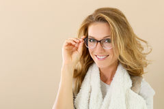 Attractive young woman posing with eyeglasses Stock Photos