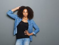 Attractive young woman posing with hand in hair Royalty Free Stock Image