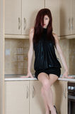 Attractive young woman posing in a kitchen setting Stock Photography