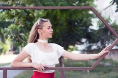 Attractive young woman posing outside Stock Photos