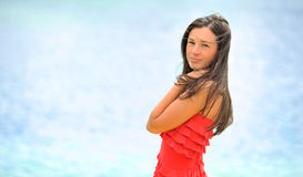Attractive young woman posing over sea background Royalty Free Stock Images