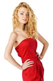 Attractive young woman posing in red dress. Stock Photos