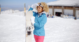 Attractive young woman posing at a ski resort Royalty Free Stock Photo