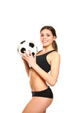 Attractive young woman posing with a soccer ball Stock Photos