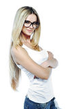 Attractive young woman posing in studio wearing sunglasses Royalty Free Stock Photography
