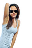 Attractive young woman posing in studio wearing sunglasses Royalty Free Stock Photo
