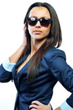 Attractive young woman posing in studio wearing sunglasses Stock Photos