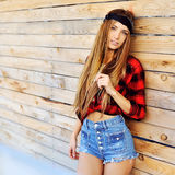 Attractive young woman posing by the wall Stock Photo