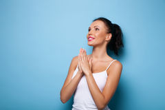 Attractive young woman is praying for good luck Stock Image