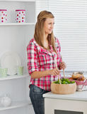 Attractive young woman preparing a salad Stock Images