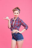 Attractive young woman is presenting sweet food Stock Image