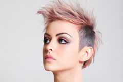 Attractive Young Woman with a Punk Hairstyle Royalty Free Stock Images