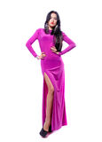 Attractive young woman in purple dress isolated Royalty Free Stock Images
